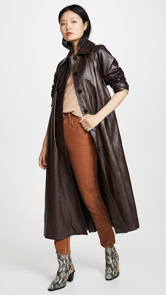 "<p>This <a href=""https://www.popsugar.com/buy/GoenJ-Faux-Leather-Trench-Coat-492712?p_name=Goen.J%20Faux%20Leather%20Trench%20Coat&retailer=shopbop.com&pid=492712&price=890&evar1=fab%3Aus&evar9=45621663&evar98=https%3A%2F%2Fwww.popsugar.com%2Ffashion%2Fphoto-gallery%2F45621663%2Fimage%2F46644706%2FGoenJ-Faux-Leather-Trench-Coat&list1=shopping%2Cfall%20fashion%2Ccoats%2Cfall%2Cwinter%2Cwinter%20fashion&prop13=mobile&pdata=1"" rel=""nofollow"" data-shoppable-link=""1"" target=""_blank"" class=""ga-track"" data-ga-category=""Related"" data-ga-label=""https://www.shopbop.com/faux-leather-trench-goenj/vp/v=1/1591683154.htm?folderID=13414&amp;fm=other-shopbysize-viewall&amp;os=false&amp;colorId=11409"" data-ga-action=""In-Line Links"">Goen.J Faux Leather Trench Coat</a> ($890) is such a statement piece.</p>"