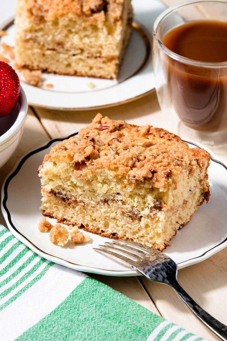 """<p>This coffee cake is bound to be the star of any afternoon tea spread. If needed, bake the night before and cover with a kitchen towel, that way it's ready to slice and serve ASAP.</p><p>Get the <a href=""""https://www.delish.com/uk/cooking/recipes/a29139335/easy-coffee-cake-recipe/"""" rel=""""nofollow noopener"""" target=""""_blank"""" data-ylk=""""slk:Classic Coffee Cake"""" class=""""link rapid-noclick-resp"""">Classic Coffee Cake</a> recipe.</p>"""