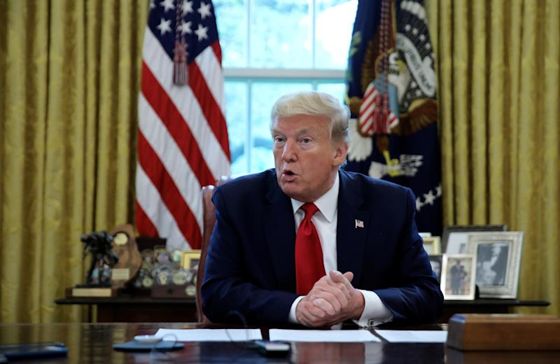 U.S. President Donald Trump answers questions during an interview with Reuters about China, the novel coronavirus (COVID-19) pandemic and other subjects in the Oval Office of the White House in Washington, U.S., April 29, 2020. REUTERS/Carlos Barria