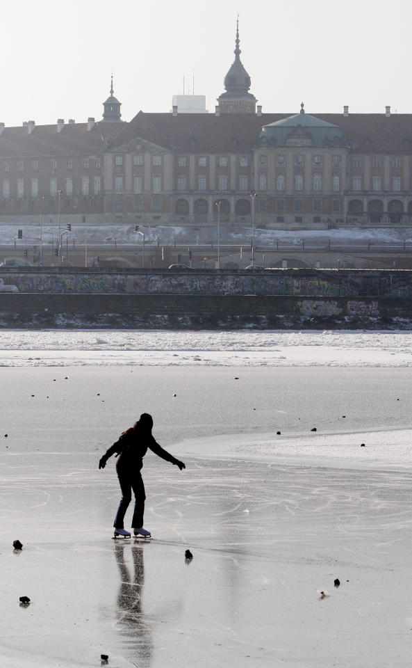 A Warsaw resident skates on the frozen River Vistula in Warsaw, Poland, Sunday, Feb. 5, 2012. Across Eastern Europe, thousands of people continued to dig out from heavy snow that has fallen during a cold snap that struck more than a week ago and has killed hundreds of people. (AP Photo/Czarek Sokolowski)