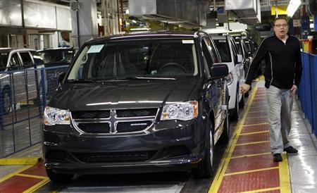 A new 2011 Dodge Grand Caravan minivan is driven off the final production line in Windsor, Ontario