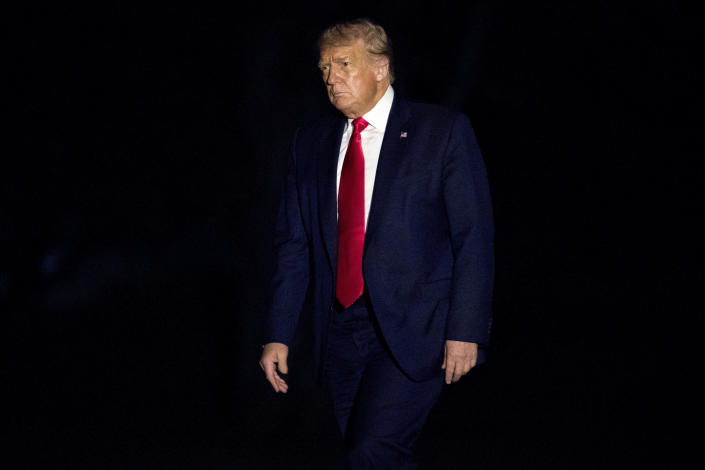 FILE - In this July 10, 2020, file photo President Donald Trump walks across the South Lawn of the White House in Washington as he returns from a trip to Florida. (AP Photo/Andrew Harnik, File)