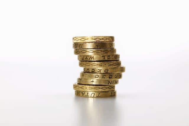 10 pound coins stacked in a pile
