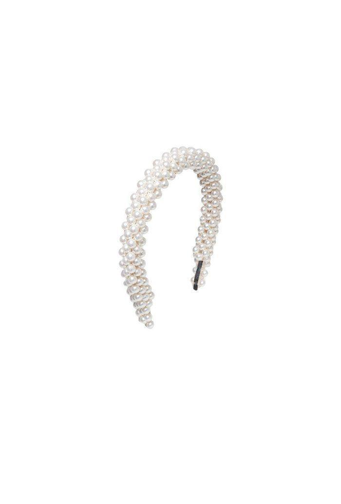 """<p><a class=""""link rapid-noclick-resp"""" href=""""https://shrimps.com/products/antonia-headband-cream"""" rel=""""nofollow noopener"""" target=""""_blank"""" data-ylk=""""slk:SHOP NOW"""">SHOP NOW</a></p><p>Shrimp's pretty pearl style would be ideal for any brides-to-be looking for a timeless headpiece – but would also be great for adding something special to any day-to-day look.</p><p>Antonia headband, £150, <a href=""""https://shrimps.com/products/antonia-headband-cream"""" rel=""""nofollow noopener"""" target=""""_blank"""" data-ylk=""""slk:Shrimps"""" class=""""link rapid-noclick-resp"""">Shrimps</a></p>"""