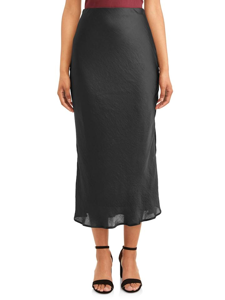 "<p>The affordable slip-inspired skirt from Walmart has a slight flow to the cut, giving it a bit more movement for holiday soirees. Pair it with <a href=""https://linksynergy.walmart.com/deeplink?id=93xLBvPhAeE&mid=2149&murl=https%3A%2F%2Fwww.walmart.com%2Fip%2FWomens-Open-toe-Pump%2F969060705&u1=RS%2CThisSkirtTrendIsNearly500%2525MorePopularThisYear%25E2%2580%2594Here%25E2%2580%2599sHowtoStyletheLook%2Cdarganb%2CDRE%2CIMA%2C681053%2C201910%2CI"" target=""_blank"">strappy statement heels like these</a> and <a href=""https://linksynergy.walmart.com/deeplink?id=93xLBvPhAeE&mid=2149&murl=https%3A%2F%2Fwww.walmart.com%2Fip%2FSofia-Jeans-High-Neck-Full-Coverage-Bodysuit-Women-s%2F731193993&u1=RS%2CThisSkirtTrendIsNearly500%2525MorePopularThisYear%25E2%2580%2594Here%25E2%2580%2599sHowtoStyletheLook%2Cdarganb%2CDRE%2CIMA%2C681053%2C201910%2CI"" target=""_blank"">a bodysuit</a> for a sleek look, or dress the slip skirt down with <a href=""https://linksynergy.walmart.com/deeplink?id=93xLBvPhAeE&mid=2149&murl=https%3A%2F%2Fwww.walmart.com%2Fip%2FWomen-s-Keds-Champion-Oxford-Canvas-Sneaker%2F188381481&u1=RS%2CThisSkirtTrendIsNearly500%2525MorePopularThisYear%25E2%2580%2594Here%25E2%2580%2599sHowtoStyletheLook%2Cdarganb%2CDRE%2CIMA%2C681053%2C201910%2CI"" target=""_blank"">white Keds sneakers</a> and <a href=""https://linksynergy.walmart.com/deeplink?id=93xLBvPhAeE&mid=2149&murl=https%3A%2F%2Fwww.walmart.com%2Fip%2FKnitwear-Oversized-Sweatshirt-Chunky-Sleeve-Knit-Jumper-Patchwork-Winter-Shirt-Baggy-Striped-Loose-Women-Blouse-For-Casual-Pullover-Sweater-Top-Long-%2F822330747&u1=RS%2CThisSkirtTrendIsNearly500%2525MorePopularThisYear%25E2%2580%2594Here%25E2%2580%2599sHowtoStyletheLook%2Cdarganb%2CDRE%2CIMA%2C681053%2C201910%2CI"" target=""_blank"">a chunky knit sweater, like this</a>.</p> <p><strong>To buy:</strong> $16 (was $20); <a href=""https://linksynergy.walmart.com/deeplink?id=93xLBvPhAeE&mid=2149&murl=https%3A%2F%2Fwww.walmart.com%2Fip%2FWomen-s-Satin-Maxi-Skirt%2F779285410%3Fselected%3Dtrue&u1=RS%2CThisSkirtTrendIsNearly500%2525MorePopularThisYear%25E2%2580%2594Here%25E2%2580%2599sHowtoStyletheLook%2Cdarganb%2CDRE%2CIMA%2C681053%2C201910%2CI"" target=""_blank"">walmart.com</a>.</p>"