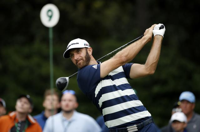Dustin Johnson of the U.S. hits off the ninth tee during third round play of the 2018 Masters golf tournament at the Augusta National Golf Club in Augusta, Georgia, U.S. April 7, 2018. REUTERS/Mike Segar