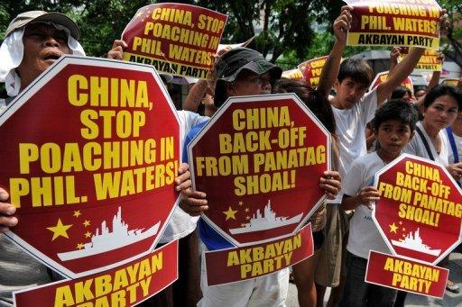 Activists are pictured during a protest in front of the Chinese Consular Office in Manila, on April 16, demanding the Chinese government to immediately pull out from Scarborough Shoal