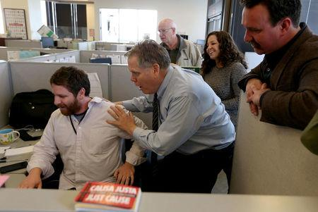 L-R, East Bay Times reporters Matthias Gafni, Thomas Peele, Harry Harris, Erin Baldassari and David Debolt react as they learn of their Pulitzer Prize win for breaking news at their office in downtown Oakland, California, U.S., April 10, 2017. The staff of the East Bay Times won journalism's highest honor for their coverage of the tragic Ghost Ship warehouse fire which killed 36 people in December 2016.  Jane Tyska/Courtesy Bay Area News Group via REUTERS