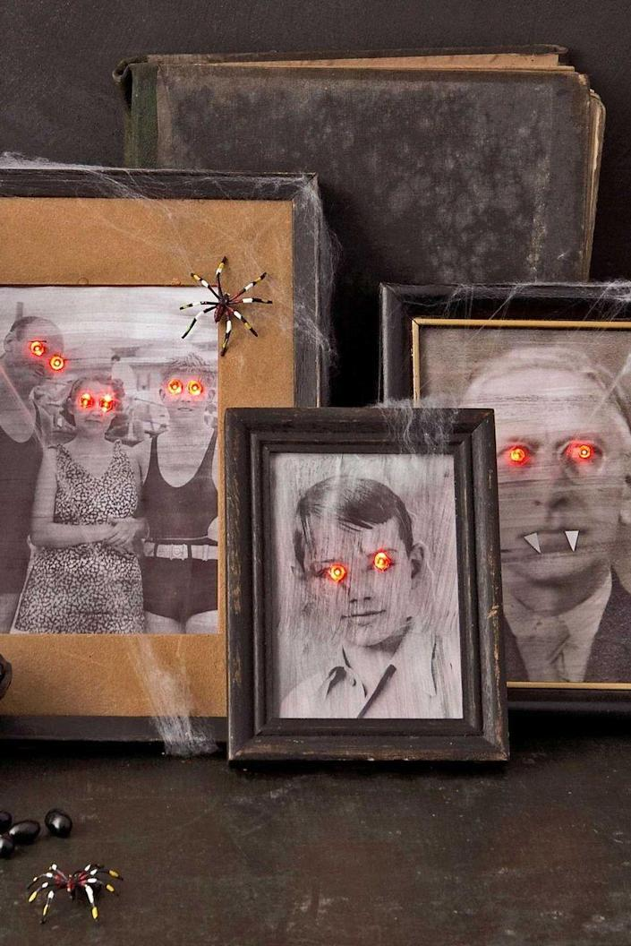 """<p>You'll never look at your family photos the same way again after giving them a creepy makeover for your Halloween party. </p><p><strong><em>Get the tutorial at <a href=""""https://www.countryliving.com/diy-crafts/how-to/a3014/paranormal-portraits-1009/"""" rel=""""nofollow noopener"""" target=""""_blank"""" data-ylk=""""slk:Country Living"""" class=""""link rapid-noclick-resp"""">Country Living</a>.</em></strong></p><p><a class=""""link rapid-noclick-resp"""" href=""""https://www.amazon.com/Certified-Christmas-Lights-Outdoor-Decorations/dp/B07H5FC74J?tag=syn-yahoo-20&ascsubtag=%5Bartid%7C10070.g.1908%5Bsrc%7Cyahoo-us"""" rel=""""nofollow noopener"""" target=""""_blank"""" data-ylk=""""slk:SHOP RED MINI LED LIGHTS"""">SHOP RED MINI LED LIGHTS</a></p>"""
