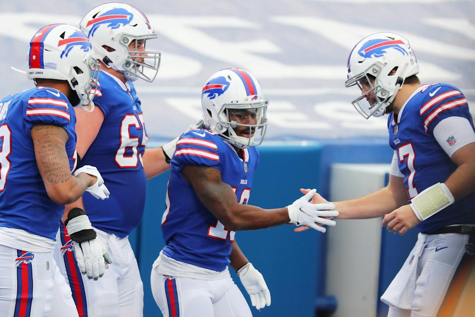 Ike Boettger, second from left, Isaiah McKenzie, center, and Josh Allen celebrate a second-quarter score. (Photo by Timothy T Ludwig/Getty Images)
