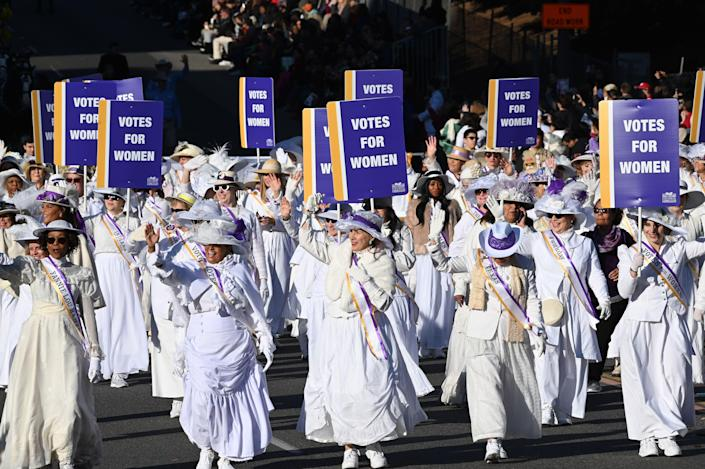 Women dressed as suffragists celebrate the 100th anniversary of the 19th amendment during the 131st Rose Parade in Pasadena, California, on January 1, 2020. (Photo by Robyn Beck / AFP)