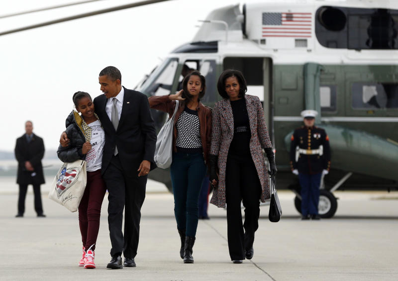 President Barack Obama, first lady Michelle Obama and their daughters Sasha, left, and Malia, walk from Marine One to board Air Force One at Chicago O'Hare International Airport, Wednesday, Nov. 7, 2012, in Chicago, the day after the presidential election. Obama defeated Republican challenger former Massachusetts Gov. Mitt Romney. (AP Photo/Carolyn Kaster)
