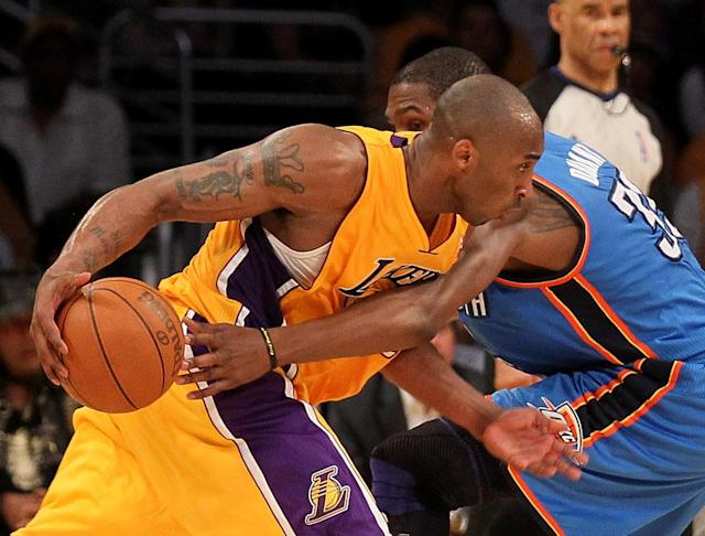LOS ANGELES, CA - MAY 19: Kobe Bryant #24 of the Los Angeles Lakers drives on Kevin Durant #35 of the Oklahoma City Thunder in the fourth quarter in Game Four of the Western Conference Semifinals in the 2012 NBA Playoffs on May 19 at Staples Center in Los Angeles, California. NOTE TO USER: User expressly acknowledges and agrees that, by downloading and or using this photograph, User is consenting to the terms and conditions of the Getty Images License Agreement. (Photo by Stephen Dunn/Getty Images)