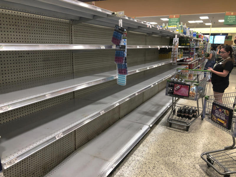 Store shelves are empty of bottled water as residents buy supplies in preparation for Hurricane Dorian, in Doral, Fla., Aug. 29, 2019. (Photo: Marcus Lim/AP)