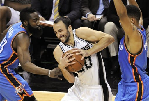 San Antonio Spurs shooting guard Manu Ginobili (20), of Argentina, is defended by Oklahoma City Thunder guard James Harden, left, and shooting guard Thabo Sefolosha, of Switzerland, during the first half of Game 5 in the NBA basketball Western Conference finals, Monday, June 4, 2012, in San Antonio. (AP Photo/Darren Abate)