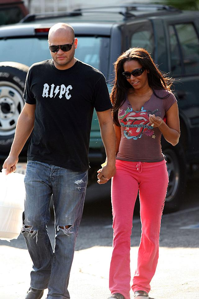 "Mel B and her hubby Stephen Belafonte keep it casual. <a href=""http://www.infdaily.com"" target=""new"">INFDaily.com</a> - February 25, 2009"