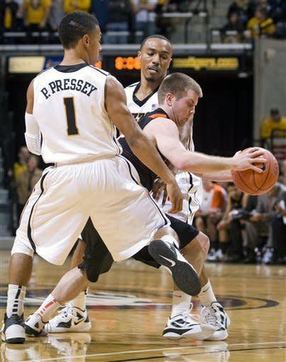 Oklahoma State's Keiton Page, center, looks for room around Missouri's Phil Pressey (1) and Matt Pressey, rear, during the first half of an NCAA college basketball game Wednesday, Feb. 15, 2012, in Columbia, Mo. (AP Photo/L.G. Patterson)