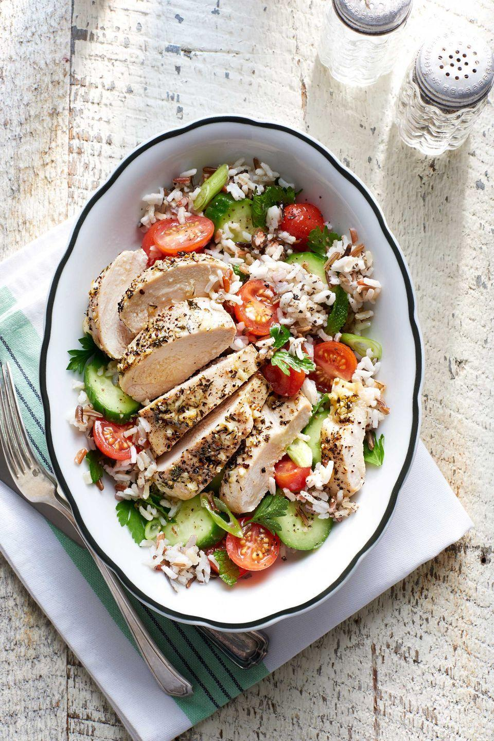 """<p>This chicken dish is a light and healthy weeknight meal that's sure to please.</p><p><strong><a href=""""https://www.countryliving.com/food-drinks/recipes/a275/greek-chicken-tomato-rice-salad-recipe-clx0315/"""" rel=""""nofollow noopener"""" target=""""_blank"""" data-ylk=""""slk:Get the recipe"""" class=""""link rapid-noclick-resp"""">Get the recipe</a>.</strong></p>"""