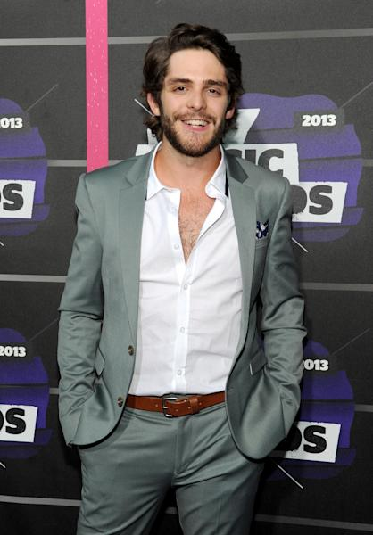 FILE - In this June 5, 2013, file photo, Thomas Rhett arrives at the 2013 CMT Music Awards in Nashville, Tenn. Thomas Rhett, whose full name is Thomas Rhett Akins Jr., grew up in the limelight of his father's success, even appearing on television and on stage singing songs with his dad, Rhett Akins. The father and son songwriters managed to get credits on five of the top 10 songs on country radio in early October 2013. (Photo by Frank Micelotta/Invision/AP, File)