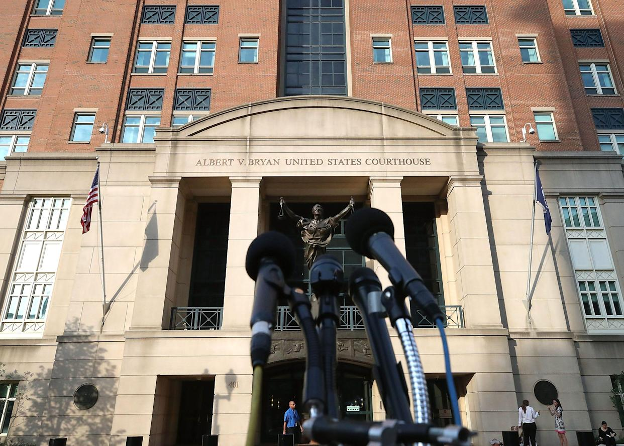 Microphones are setup in front of the Albert V. Bryan United States Courthouse on August 16, 2018 in Alexandria, Virginia.