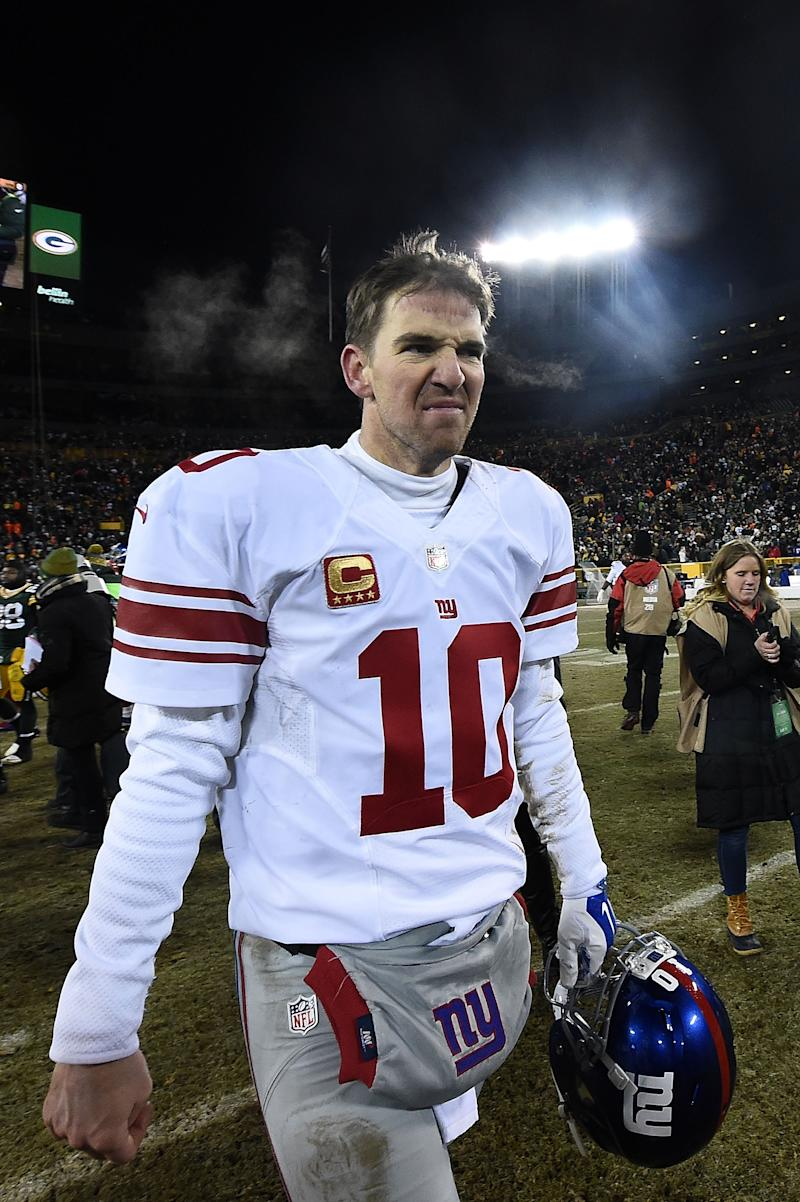 GREEN BAY, WI - JANUARY 08: Eli Manning #10 of the New York Giants leaves the field following the NFC Wild Card game against the Green Bay Packers at Lambeau Field on January 8, 2017 in Green Bay, Wisconsin. The Packers defeated the Giants 38-13. (Photo by Stacy Revere/Getty Images)