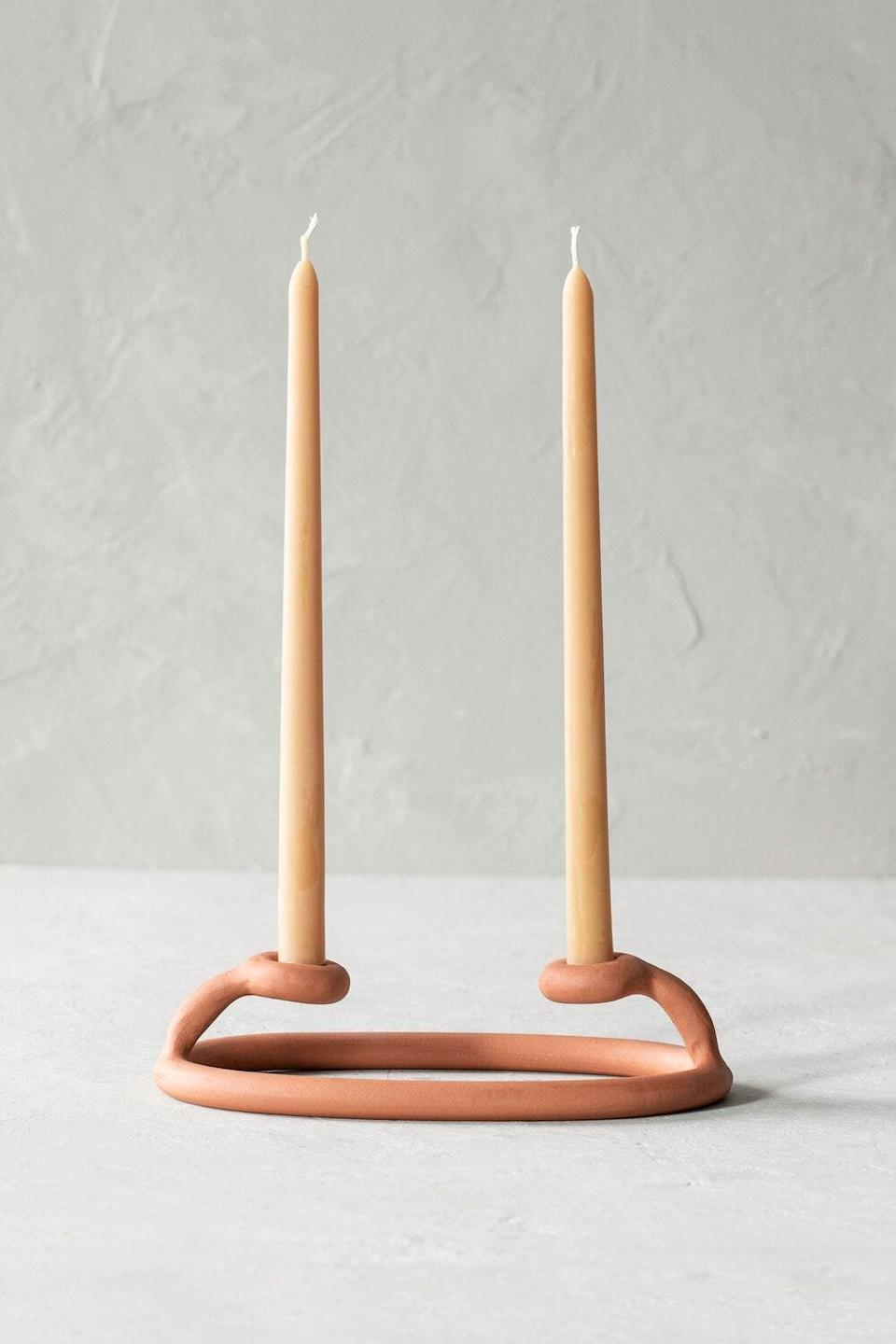 """Zhuzh up her space with a unique accent piece from Brooklyn ceramics studio Sin. The brand's duo candle holder is the perfect topper for any dining room table, kitchen island, or credenza. $58, Lulu & Georgia. <a href=""""https://www.luluandgeorgia.com/sin-duo-candlestick-terracotta"""" rel=""""nofollow noopener"""" target=""""_blank"""" data-ylk=""""slk:Get it now!"""" class=""""link rapid-noclick-resp"""">Get it now!</a>"""
