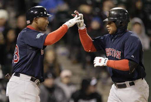 Boston Red Sox's Darnell McDonald, right, celebrates with Marlon Byrd after hitting a solo home run during the ninth inning of a baseball game against the Chicago White Sox in Chicago, Friday, April 27, 2012. The Red Sox won 10-3. (AP Photo/Nam Y. Huh)