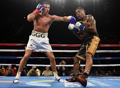Gennady Golovkin (L) lands a left hook on Willie Monroe during their May 16 fight. (AFP)