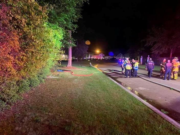 Emergency services personnel stand near the site of a Tesla vehicle crash in The Woodlands, Texas (via REUTERS)