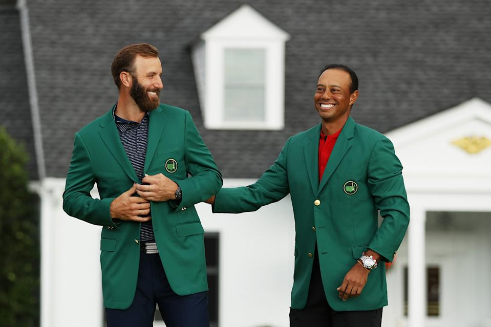 AUGUSTA, GEORGIA - NOVEMBER 15: Dustin Johnson of the United States is awarded the Green Jacket by Masters champion Tiger Woods of the United States during the Green Jacket Ceremony after winning the Masters at Augusta National Golf Club on November 15, 2020 in Augusta, Georgia. (Photo by Patrick Smith/Getty Images)
