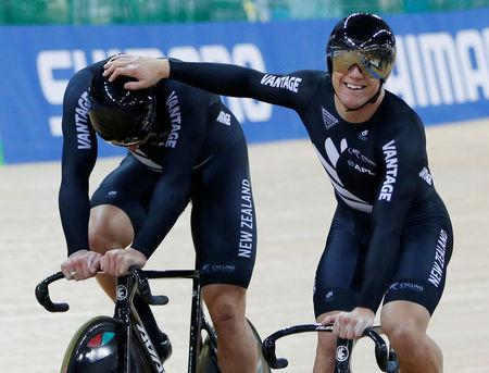 Cycling - UCI Track World Championships - Men's Team Sprint, Final - Hong Kong, China - 12/4/17 - New Zealand's Ethan Mitchell celebrates with Edward Dawkins. REUTERS/Bobby Yip