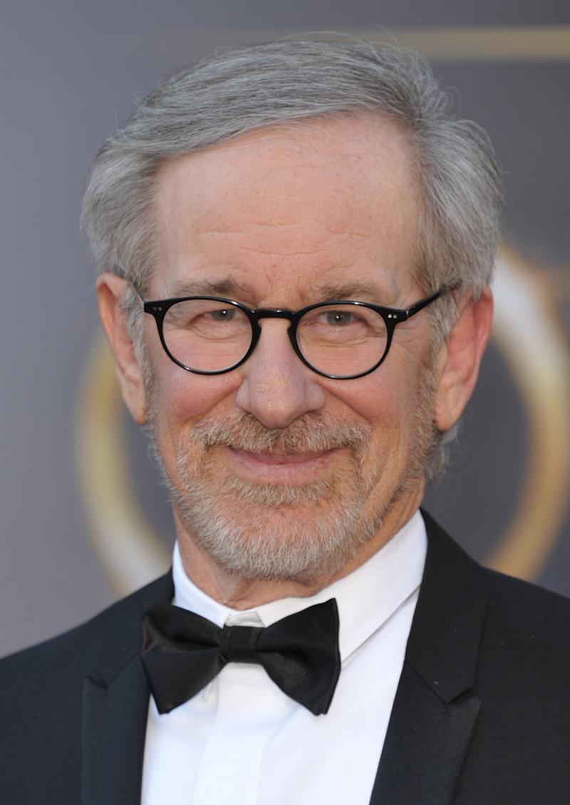 """FILE - In this Feb. 24, 2013 file photo, director Steven Spielberg arrives at the Oscars at the Dolby Theatre in Los Angeles. Spielberg has his sights set on his next film. A spokeswoman for DreamWorks Studios said Thursday, May 2, 2013, the filmmaker plans to direct Bradley Cooper in an adaptation of the best-selling book """"American Sniper."""" (Photo by John Shearer/Invision/AP, File)"""