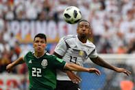 <p>Mexico's forward Hirving Lozano (L) vies with Germany's defender Jerome Boateng during the Russia 2018 World Cup Group F football match between Germany and Mexico at the Luzhniki Stadium in Moscow on June 17, 2018. (Photo by Yuri CORTEZ / AFP) </p>
