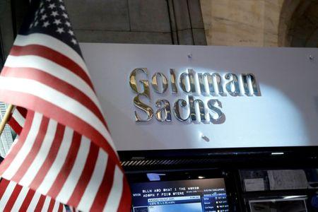FILE PHOTO: A view of the Goldman Sachs stall on the floor of the New York Stock Exchange in New York, U.S. on July 16, 2013. REUTERS/Brendan McDermid/File Photo