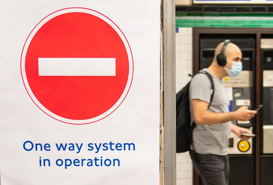 A one way system sign at Clapham Common underground station, London, as train services increase this week as part of the easing of coronavirus lockdown restrictions.