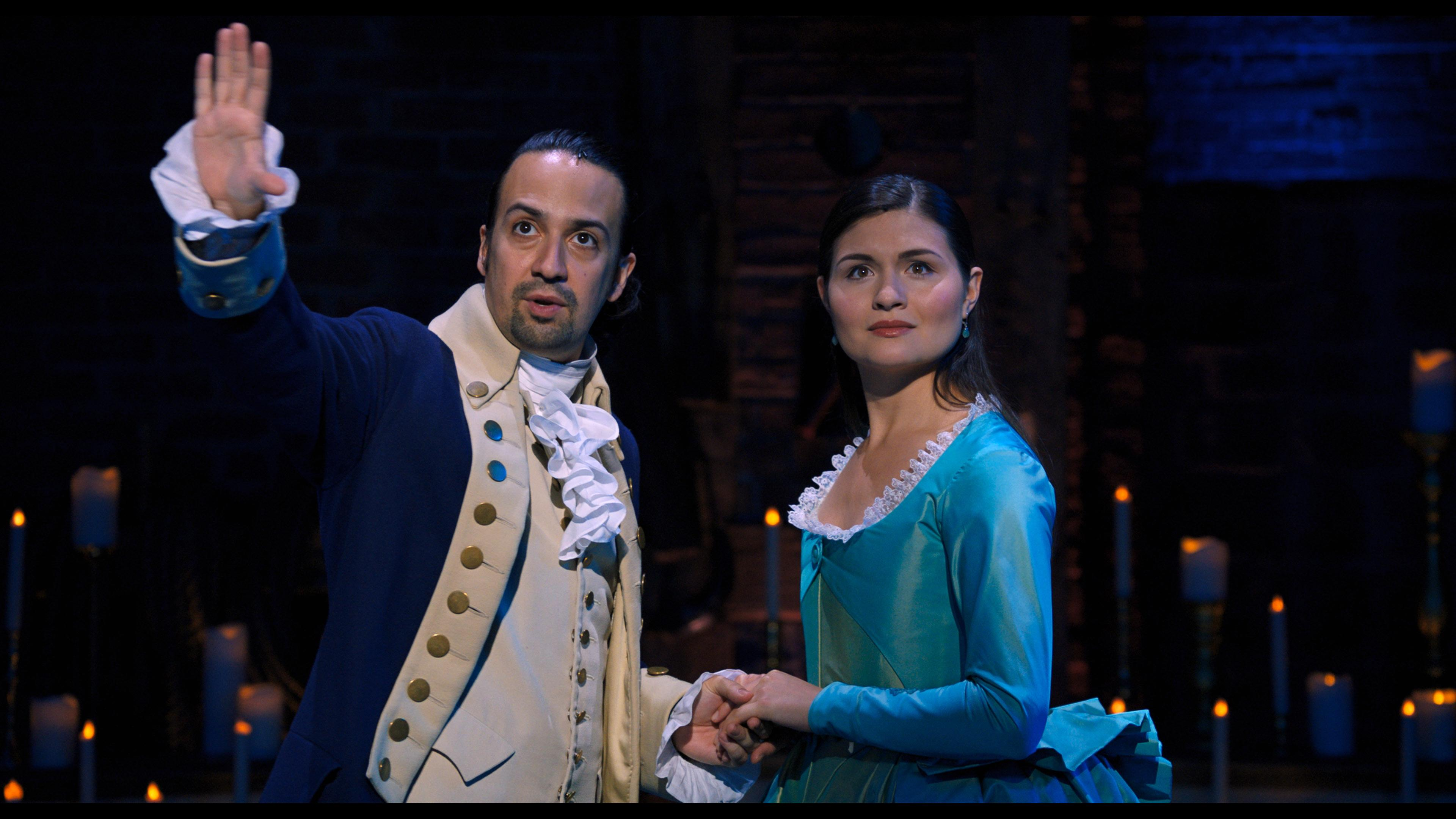 Lin-Manuel Miranda is Alexander Hamilton and Phillipa Soo is Eliza Hamilton in HAMILTON, the filmed version of the original Broadway production (Credit: Disney)