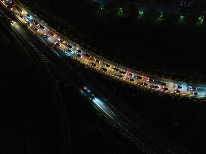 Cars queueing at a highway toll station in Wuhan on April 8, 2020.