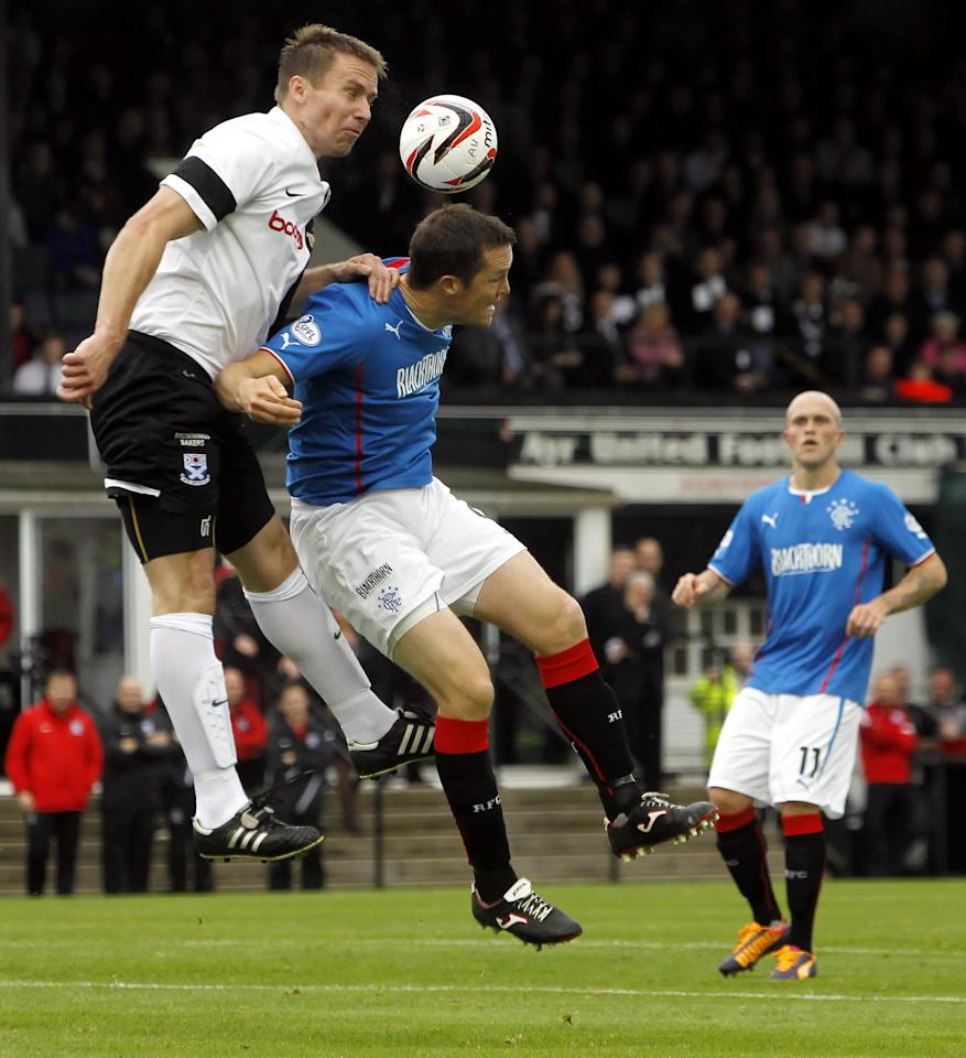 Rangers' John Daly (centre) and Ayr United's Martyn Campbell fight for the ball during the Scottish League One match at Somerset Park, Ayr.