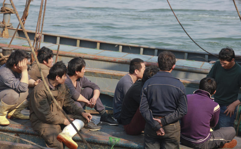 In this Monday May 21, 2012 photo, Chinese fishing crew members rest on their boat on the way back home after 13 days in North Korean custody at a harbor in Dalian, in northeastern China's Liaoning province. China's leadership is hitting a rough patch with ally North Korea under its new leader Kim Jong Un, as Beijing finds itself wrong-footed in episodes including Pyongyang's rocket launch and the murky detention of Chinese fishing boats. (AP Photo) CHINA OUT