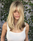"""Not sure what to do with your hair? Add a bang, says Alan Vuong, owner of <a href=""""http://blancsalon.com/"""" rel=""""nofollow noopener"""" target=""""_blank"""" data-ylk=""""slk:Salon Blanc"""" class=""""link rapid-noclick-resp"""">Salon Blanc</a> in Honolulu, who says bangs are popular on all lengths for 2020, but especially when paired with long layers. """"Together they flow seamlessly alongside the contour of your face, with the bangs bringing out your eyes,"""" he says. He notes that soft sideswept bangs, curtain bangs, and middle-part bangs are all trending, but he especially likes middle-part bangs paired with his signature chandelier layer cut (the long, soft layers you see in the photo here). To get the same look, he says to ask for """"long layers at the back and smooth, graduated layers to frame your face."""""""