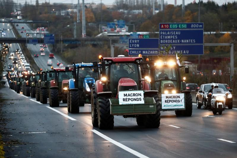 French farmers drive on the A6 motorway during a protest on their way to Paris
