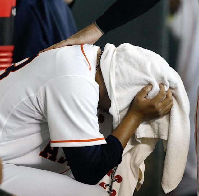 Houston Astros relief pitcher Chia-Jen Lo (63) buries his head in a towel after giving up a grand slam home run to Minnesota Twins' Chris Colabello (55) in the ninth inning of a baseball game, Monday, Sept. 2, 2013, in Houston. The Twins won 10-6. (AP Photo/Bob Levey)