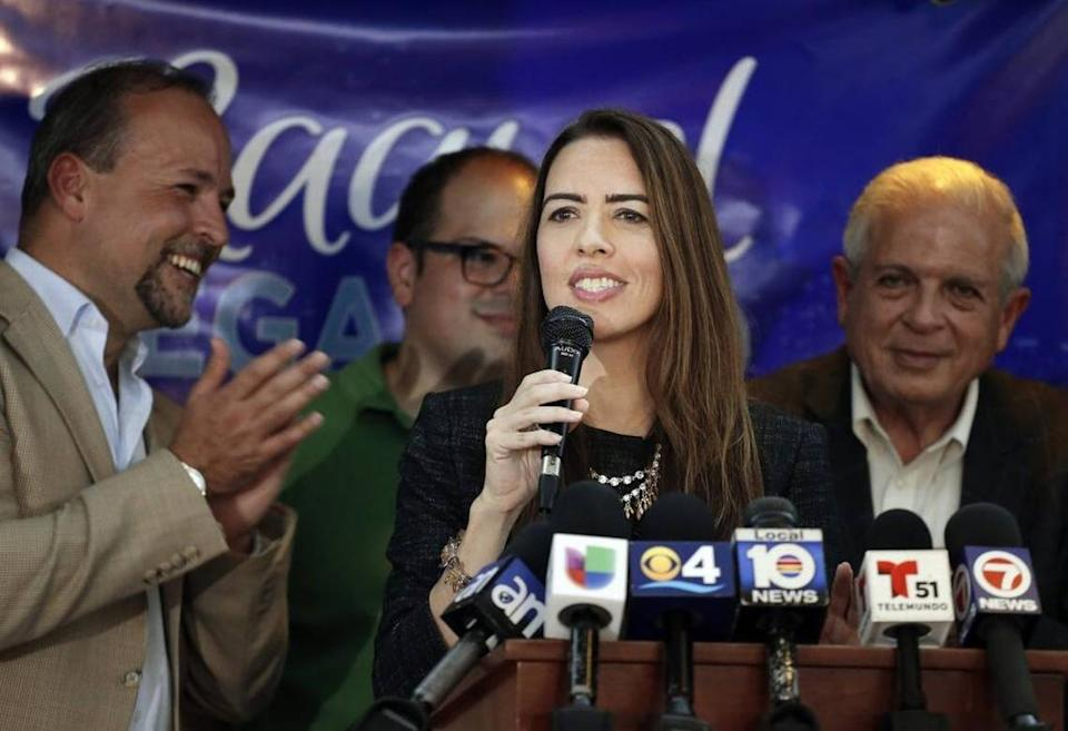 Raquel Regalado stands with brothers Tommy Regalado, left, and Jose Regalado, back, and father, Tomás Regalado, right, after making the runoff election for county mayor in 2016.