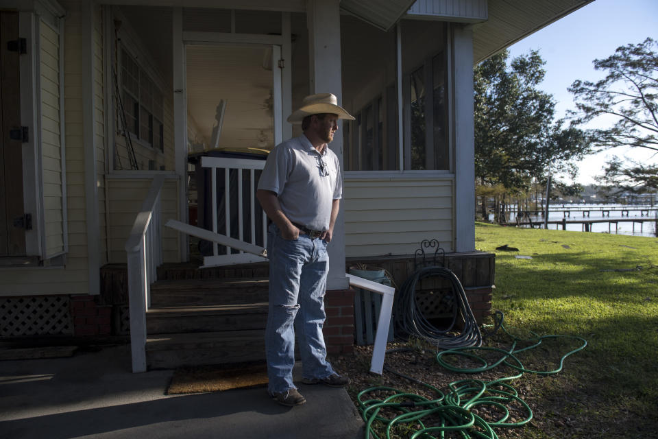 Lucas Simon surveys the damage to his house along Lake Arthur the day after Hurricane Delta on Saturday, Oct. 10, 2020. Simon, who is a crawfish, soybean, rice, and cattle farmer said he lost three cows because of mosquitoes following Hurricane Laura. (Chris Granger/The Advocate via AP)