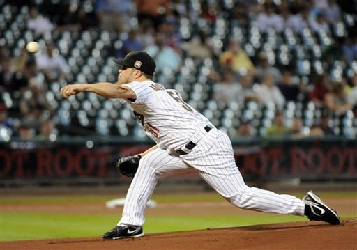 Houston Astros' Wandy Rodriguez releases a pitch against the Kansas City Royals in the second inning of a baseball game, Tuesday, June 19, 2012, in Houston. (AP Photo/Pat Sullivan)