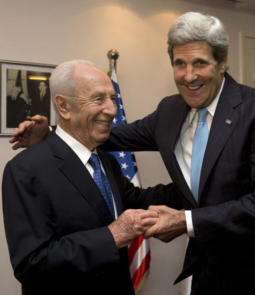 U.S. Secretary of State John Kerry, right, embraces Israeli President Shimon Peres before their meeting over dinner in Jerusalem on Friday, June 28, 2013. Kerry shuttled between Israelis and Palestinians Friday in his latest diplomatic mission to coax the two sides back to the negotiating table and revive the Mideast peace process. (AP Photo/Jacquelyn Martin, Pool)