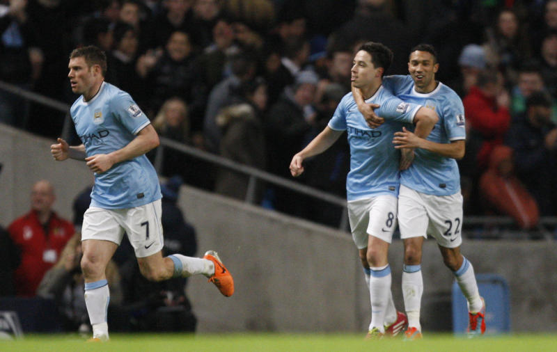 Manchester City's Samir Nasri, centre, celebrates after scoring the second goal of the game against Chelsea during their English FA Cup fifth round soccer match at the Etihad Stadium, Manchester, England, Saturday, Feb. 15, 2014. (AP Photo/Jon Super)