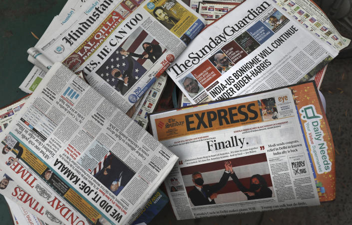 Copies of newspapers show the U.S. presidential election reports on their front pages before they get delivered to households in New Delhi, India, Sunday, Nov. 8, 2020. (AP Photo/Manish Swarup)
