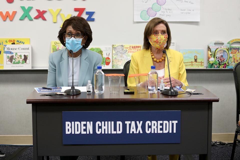 LOS ANGELES, CA - AUGUST 12: Rep. Maxine Waters, left, D-Los Angeles, and House Speaker Nancy Pelosi, D-San Francisco, hold a news conference to discuss the importance of the Child Tax Credit at the Ethel Bradley Early Education Center Thursday, Aug. 12, 2021 in Los Angeles, CA. (Gary Coronado / Los Angeles Times via Getty Images)