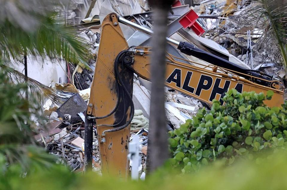 A crane sifts through rubble at the Champlain Towers South Condo in Surfside, Florida, Friday, June 25, 2021. The apartment building partially collapsed on Thursday, June 24.